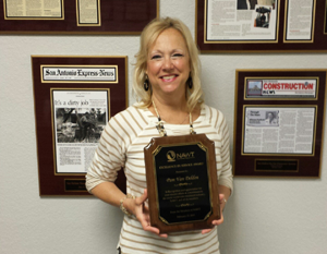 Pam Van Delden wins Excellence in Service Award from NAWT