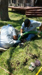 Van Delden technicians cleaning a septic tank.