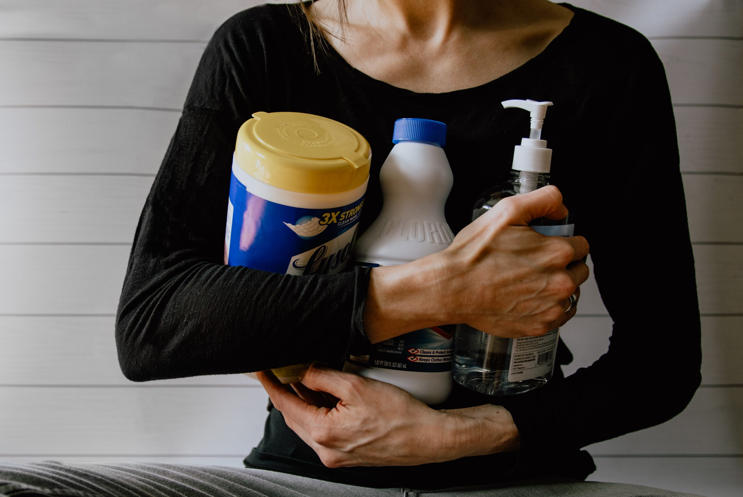 woman holding cleansers